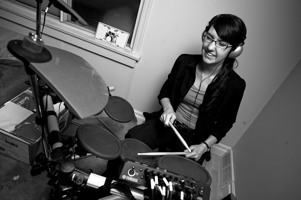 Laura learned how to play a beat on Mike's new electronic kit.