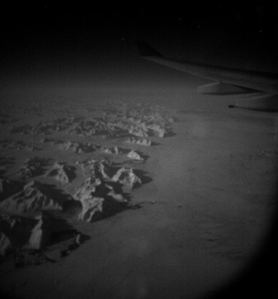 Snapped this from 39,000 feet in the middle of the night (hence the grain). This is the eastern edge of Greenland. For the photo nerds, this was taken at f/1.4, 1/4 of a second at ISO 3200. Not bad, not bad.
