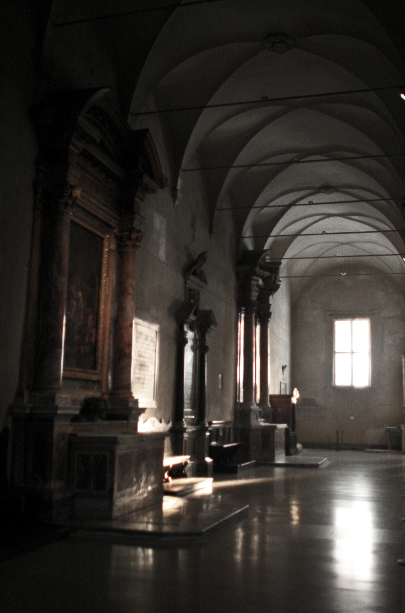 Quiet corridor of a church in Roma, Italy.