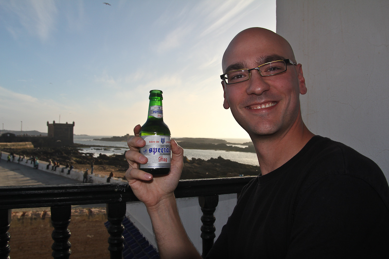 Chris enjoying Morocco's special brew of beer.