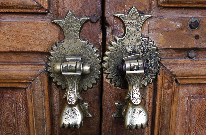 The door knockers on Shah Mosque in the ......square.