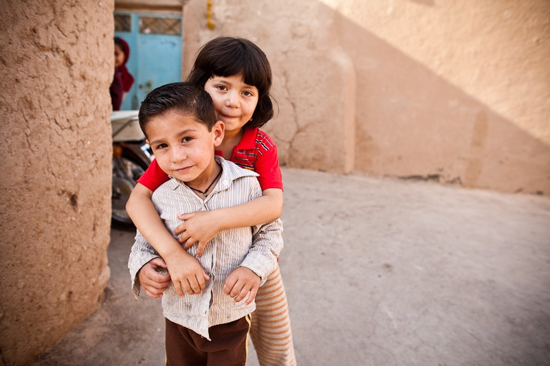 Some children we met in Yazd. In the background you can see one of two older girls who felt that being photographed would maybe be inappropriate. It's still okay to peek around the corner though.