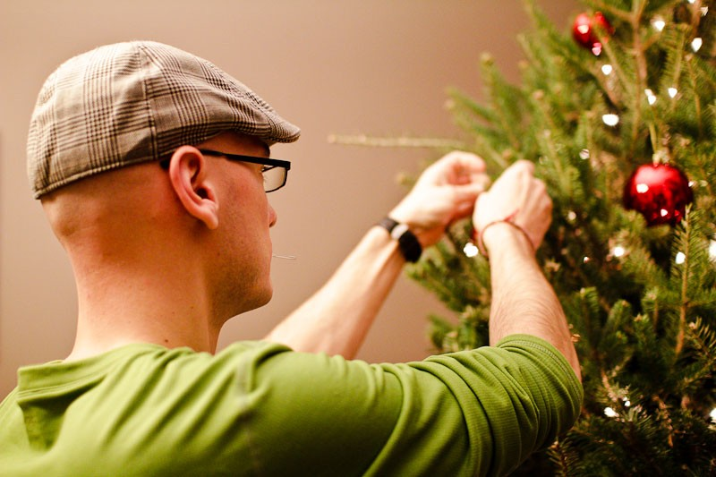 Chris decorating our first Christmas tree.