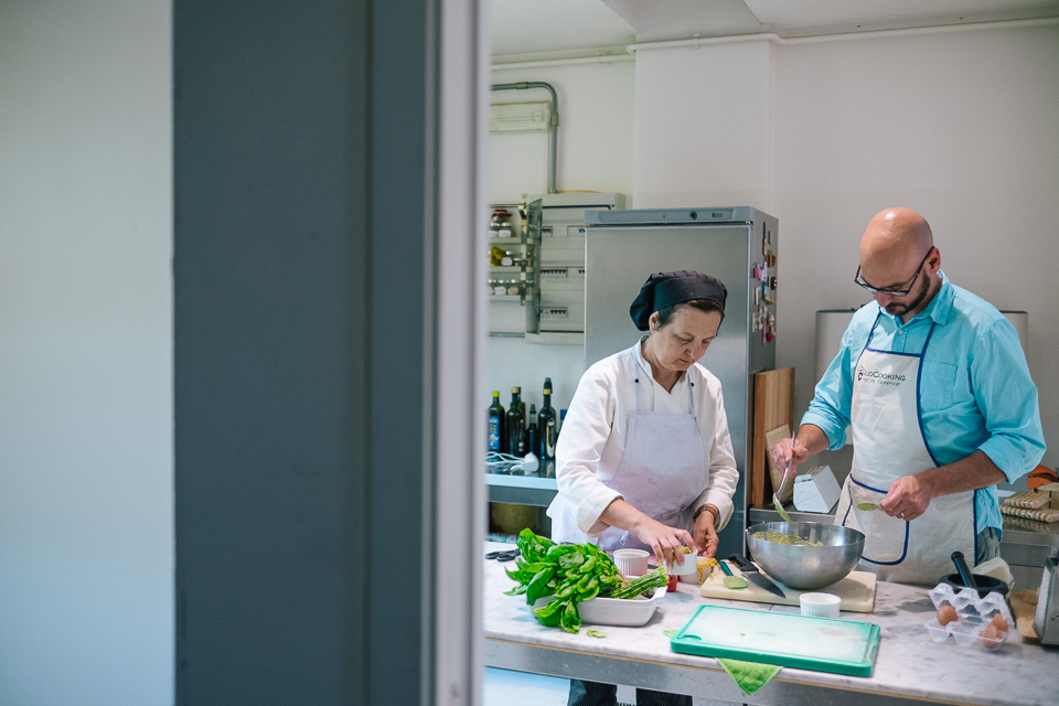 "Marcella, the Chef and owner of the Giglio Cooking School works with Chris to make the ""sformato di zucchini passati"" (zucchini pastry) or as referred to by Marcella, ""the green children""."