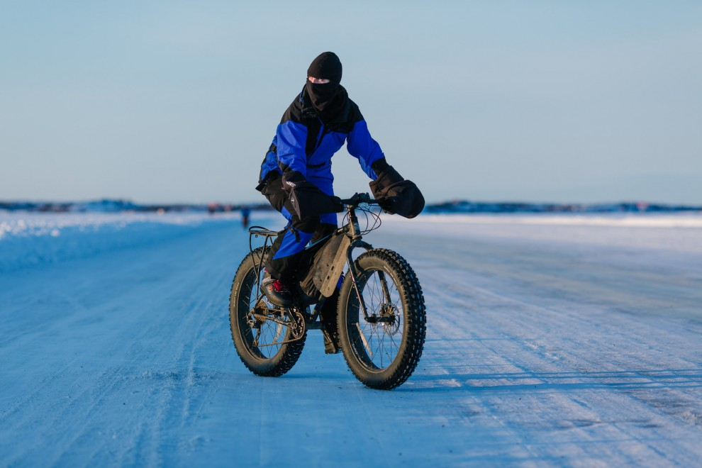 "This is a ""fat bike"", which means winter can't stop you from enjoying a bike ride! Glenn and Eliza own 4 of them, so along with many other things, we brought them up in the Uhaul trailer we rented. This is me riding. I'm very bundled to protect myself from the -25 degree weather."