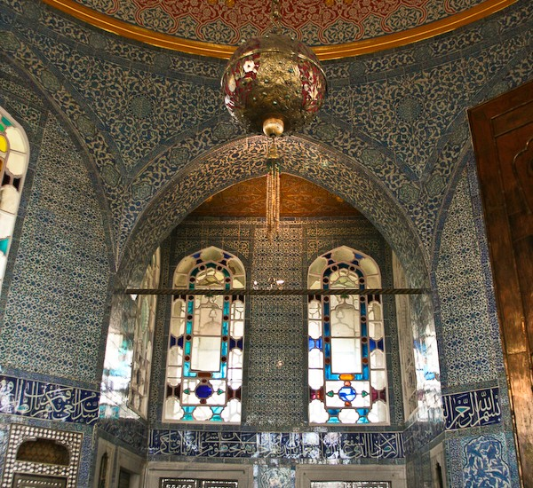 This is the interior of a building called the Baghdad Kiosk, located in the residential area of the sultan. It is one of many excellent examples of the famous blue Iznik tiles found throughout Ottoman architecture in Turkey.