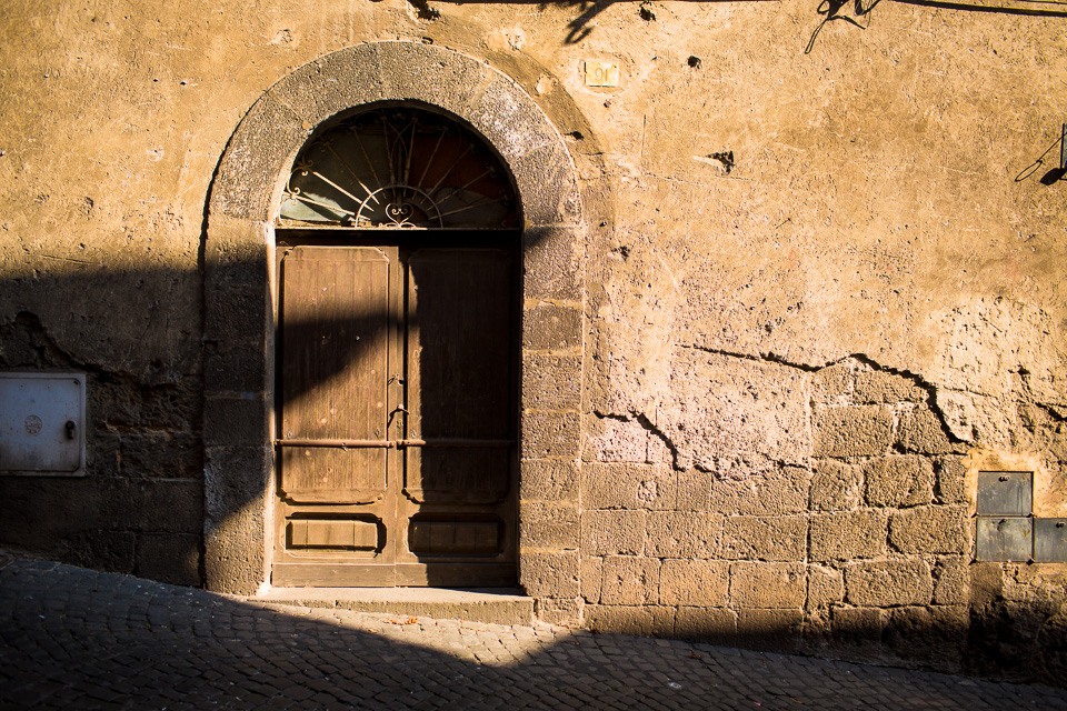 The sun dropped in the sky and we enjoyed a golden hour walk through Orvieto. I took the opportunity to photograph some of the local doors.